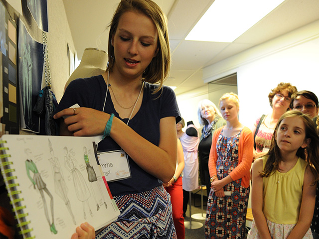 Girl showing her fashion designs
